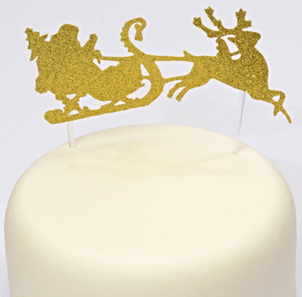 Santa and his sleigh cake topper